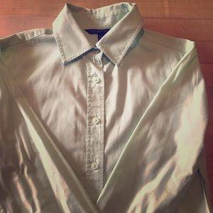Mint green button down shirt.